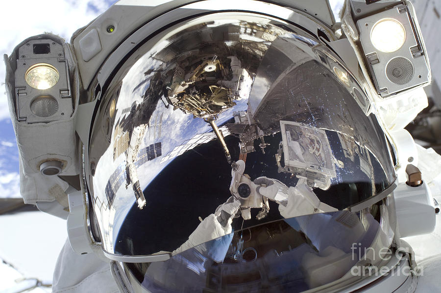 Astronaut Uses A Digital Still Camera Photograph