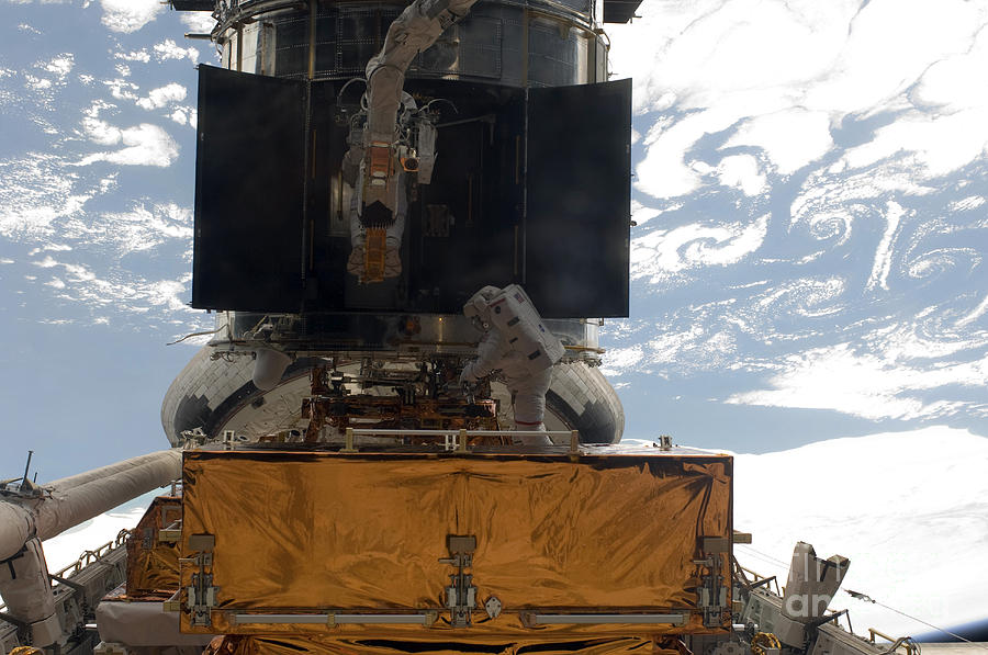 Outer Space Photograph - Astronauts Working On The Hubble Space by Stocktrek Images