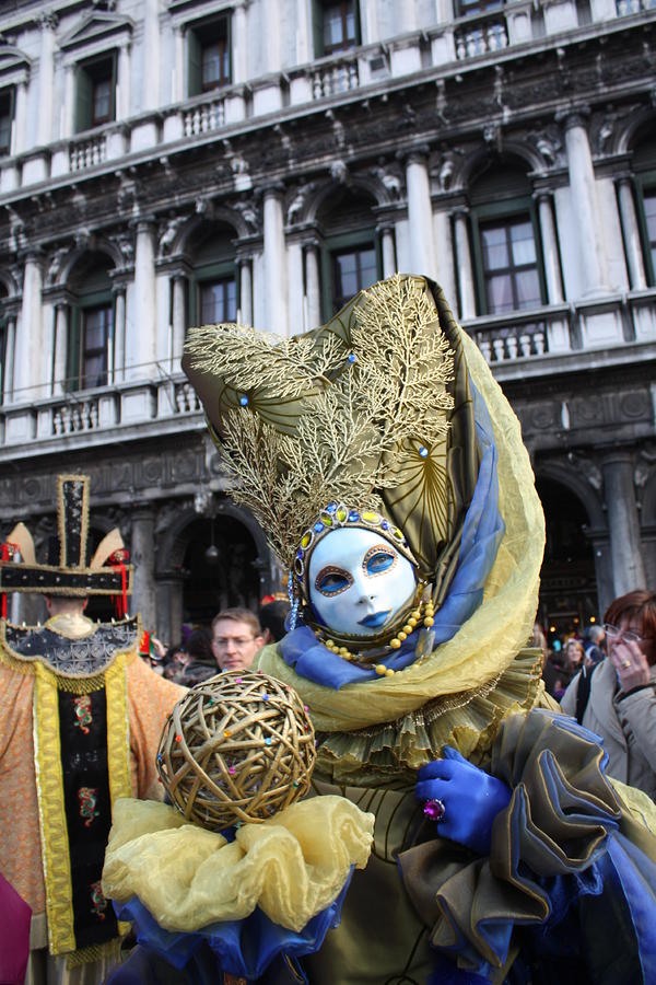 Carnival-goer In Blue And Gold Photograph