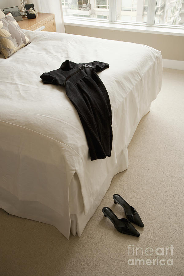 Dress Lying On Bed Photograph