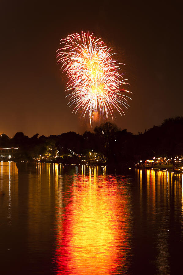 Fireworks Over A River Photograph