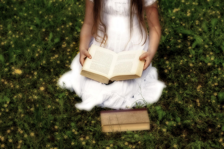 Girl Is Reading A Book Photograph
