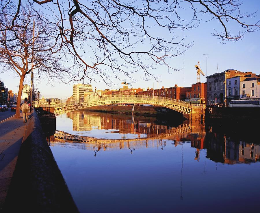 Background People Photograph - Hapenny Bridge, River Liffey, Dublin by The Irish Image Collection