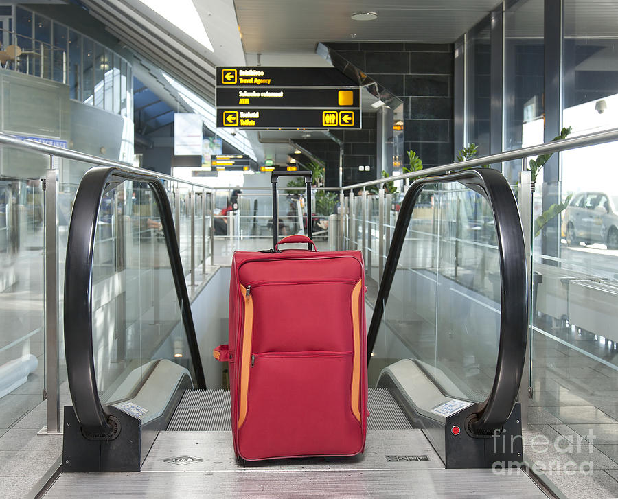Luggage At The Top Of An Escalator Photograph