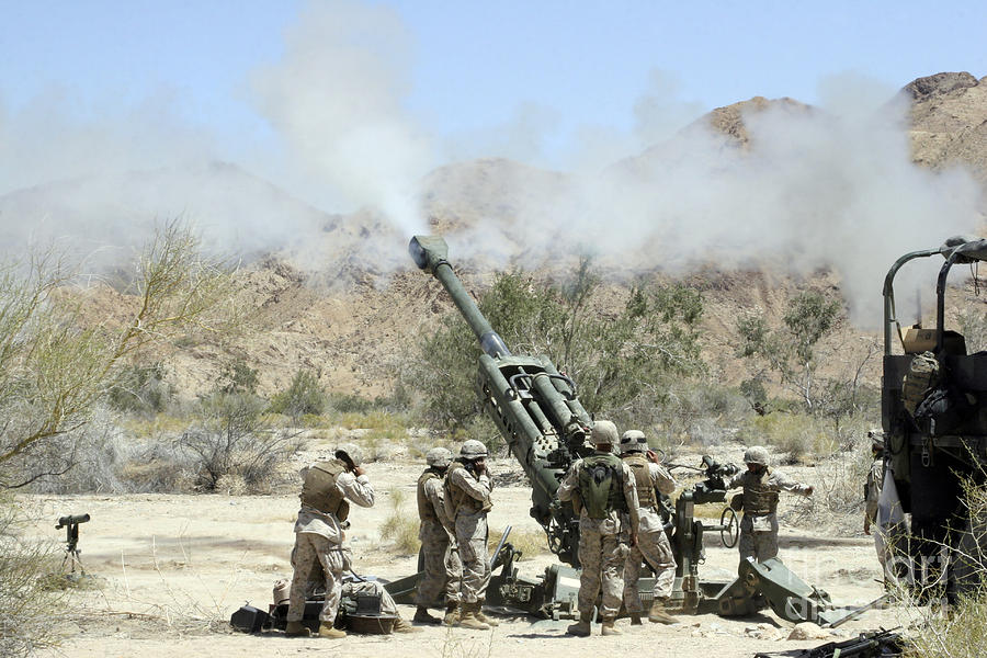 Marines Shoot 100-pound Rounds Photograph