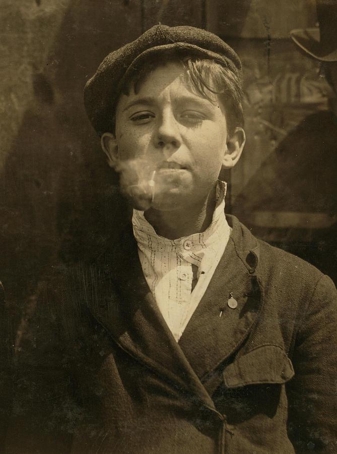 Portrait Of A Boy Smoking A Pipe Photograph