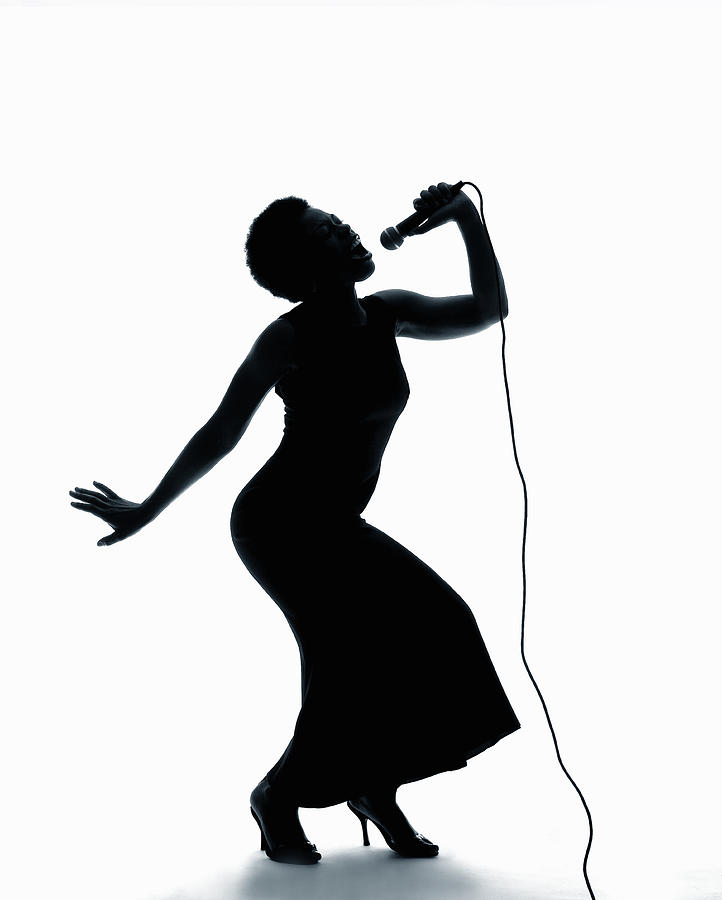 Silhouette Of Female Singer Singing On Microphone ...
