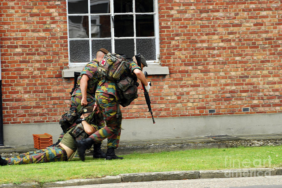 Armed Forces Photograph - Soldiers Of The Belgian Army Helping by Luc De Jaeger
