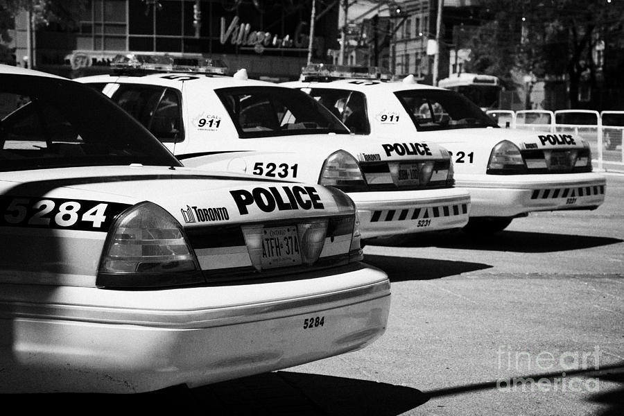 Toronto Police Squad Cars Outside Police Station In Downtown Toronto Ontario Canada Photograph  - Toronto Police Squad Cars Outside Police Station In Downtown Toronto Ontario Canada Fine Art Print