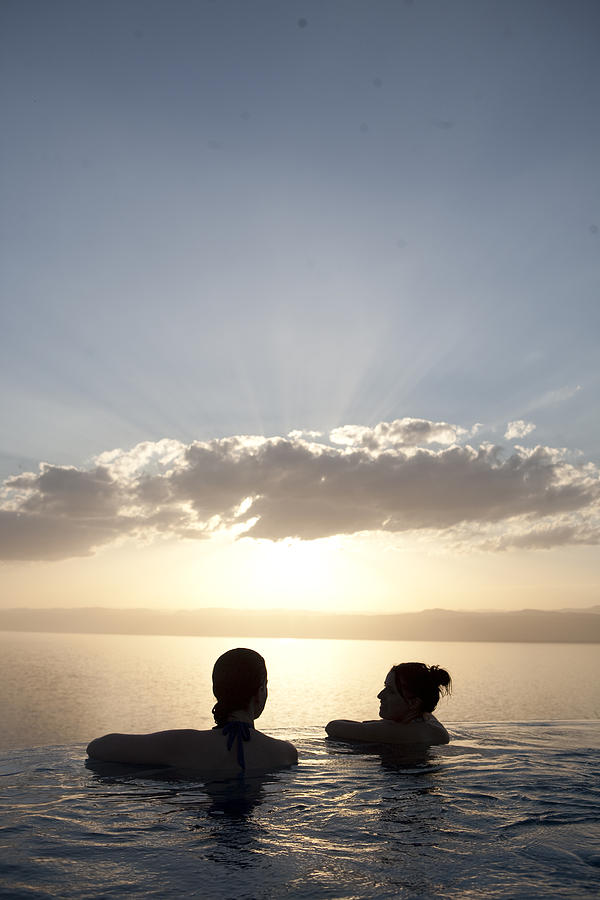 Two Friends Enjoy The Sunset Photograph