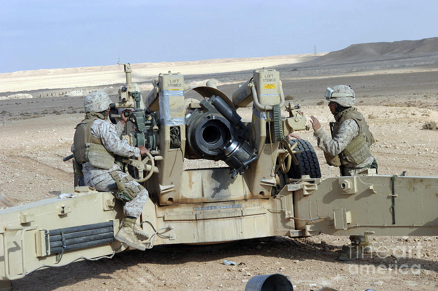 U.s. Marines Prepare To Fire A Howitzer Photograph