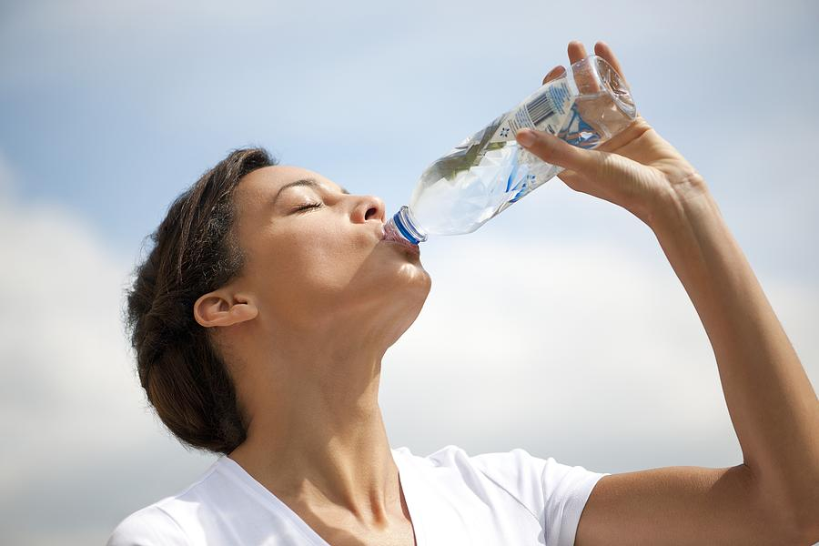 Woman Drinking Bottled Water Photograph