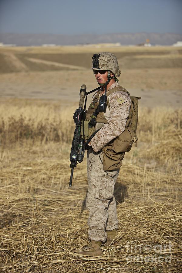 Field Photograph - U.s. Marine Patrols A Wadi Near Kunduz by Terry Moore