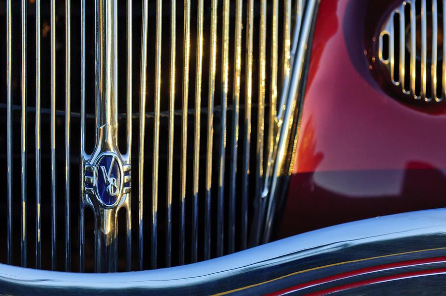 1936 Ford Phaeton Photograph - 1936 Ford Phaeton V8 Grille Emblem by Jill Reger