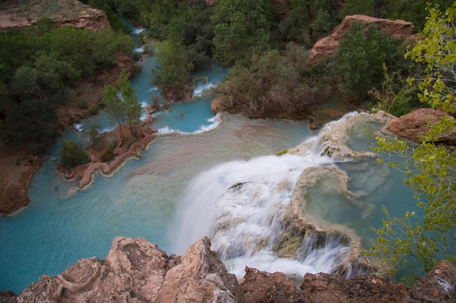 A Blue Waterfall Wets The Arid Photograph