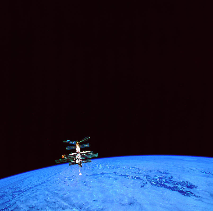 Square Photograph - A Space Station Orbiting Above The Earth by Stockbyte