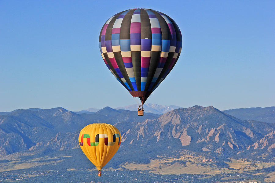2 Balloons Flying Over The Flatirons Photograph