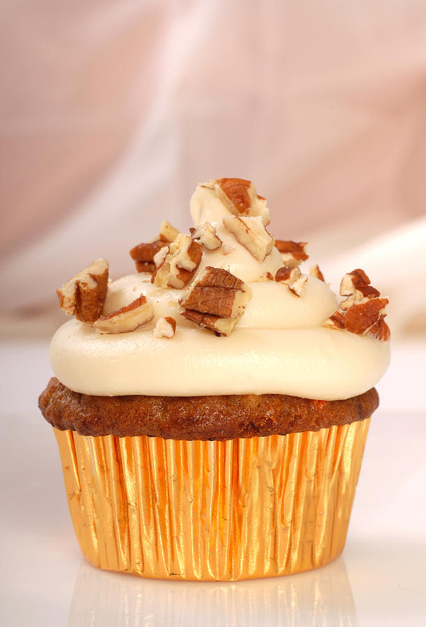 carrot-cake-cupcake-with-cream-cheese-frosting-and-nut-david-smith.jpg
