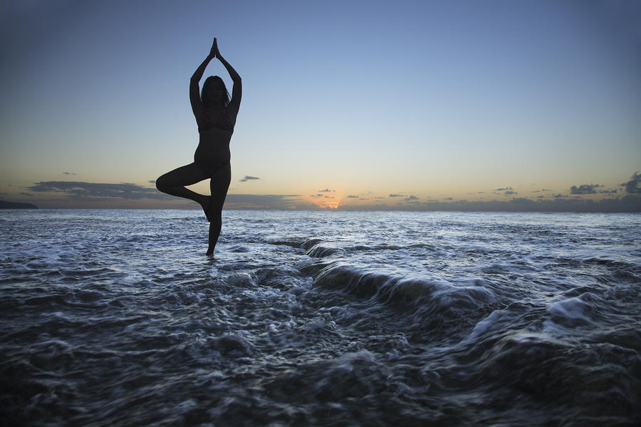Female Doing Yoga At Sunset Photograph