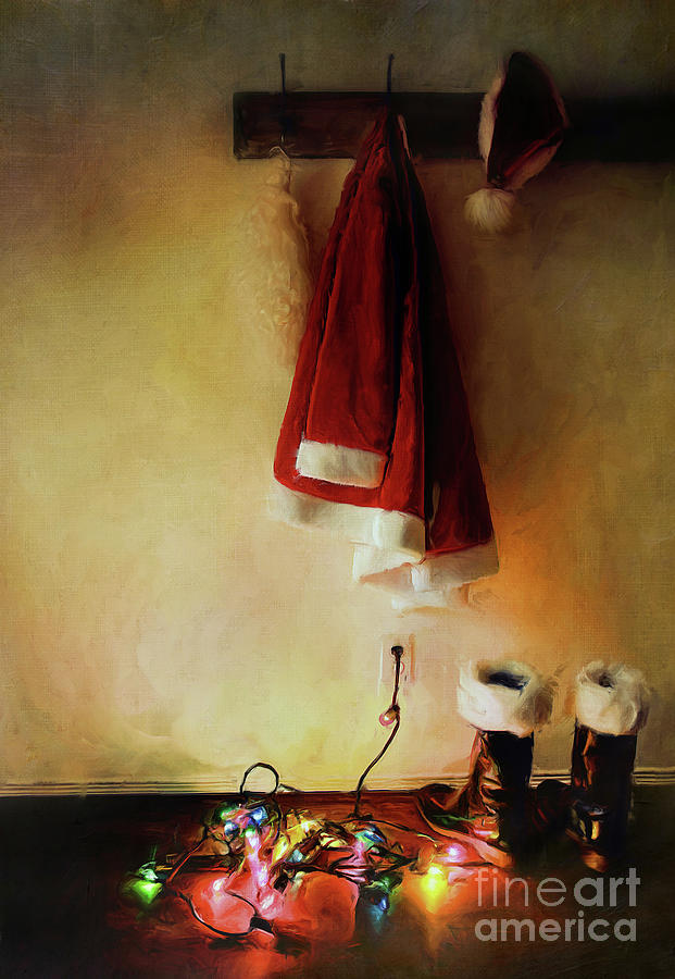 Santa Costume Hanging On Coat Hook With Christmas Lights Photograph