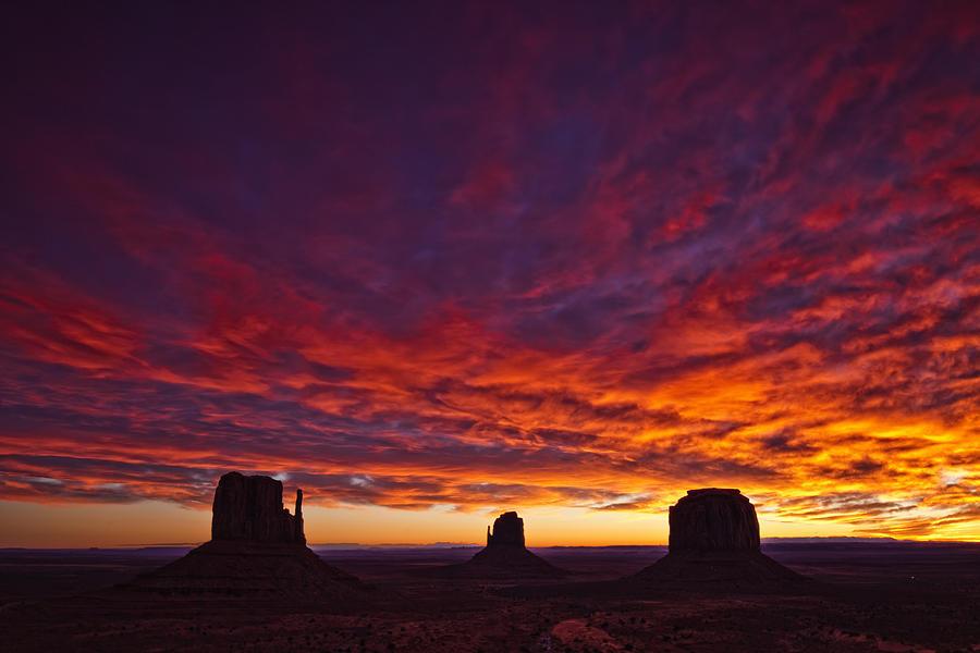 Light Photograph - Sunrise Over Monument Valley, Arizona by Robert Postma