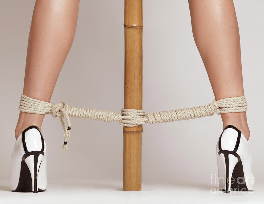 Woman Legs Tied With Ropes To Bamboo Photograph  - Woman Legs Tied With Ropes To Bamboo Fine Art Print