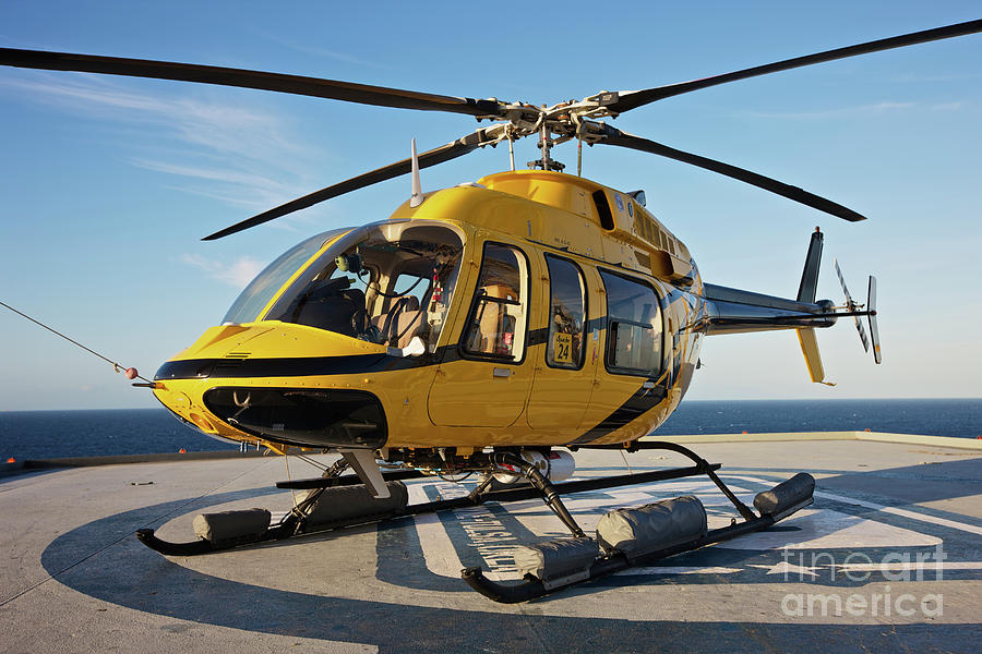 Louisiana Photograph - A Bell 407 Utility Helicopter by Terry Moore