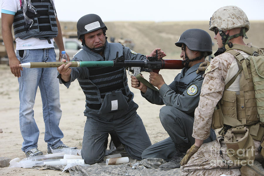 An Afghan Police Student Loads A Rpg-7 Photograph