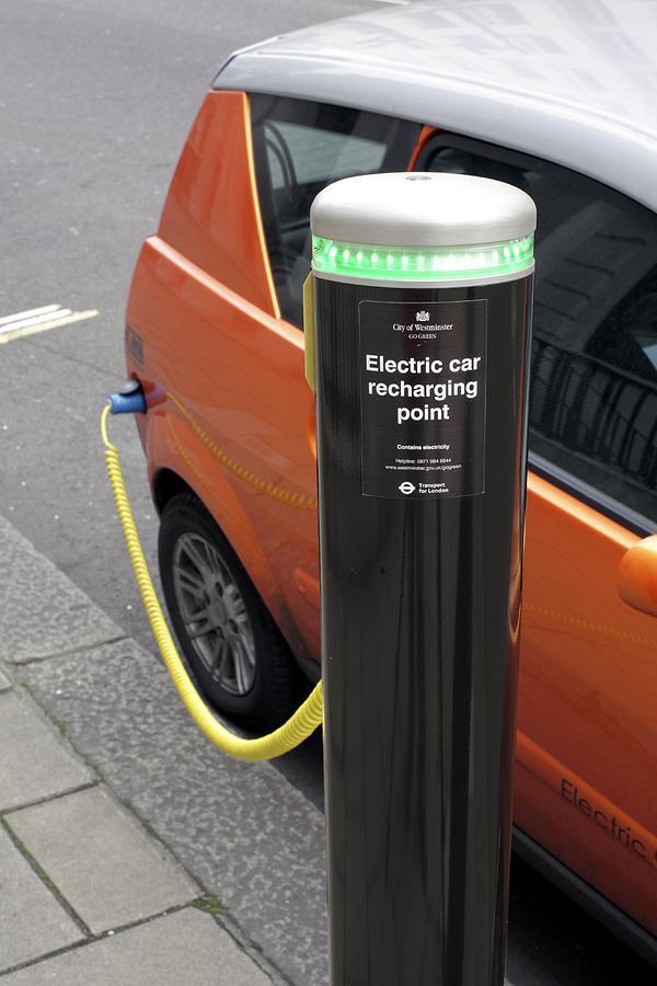 Mega City Photograph - Recharging An Electric Car by Martin Bond