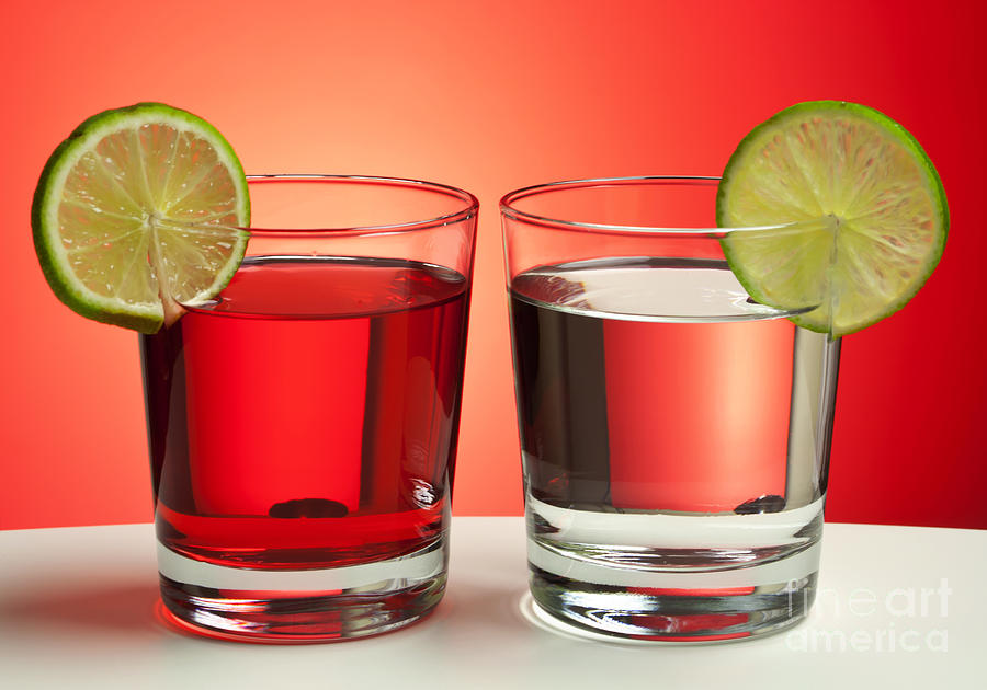 Drink Photograph - Two Red Drinks by Blink Images