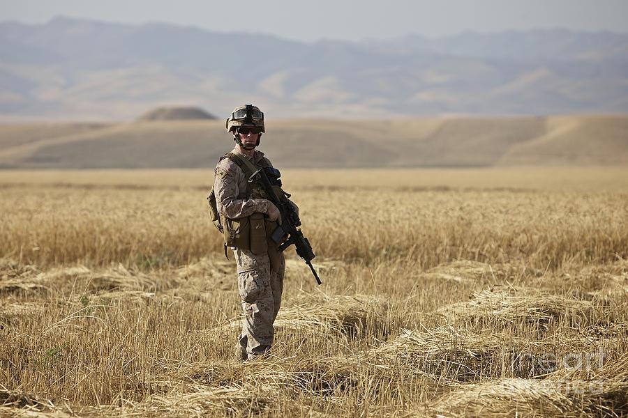 Patrol Photograph - U.s. Marine Patrols A Wadi Near Kunduz by Terry Moore