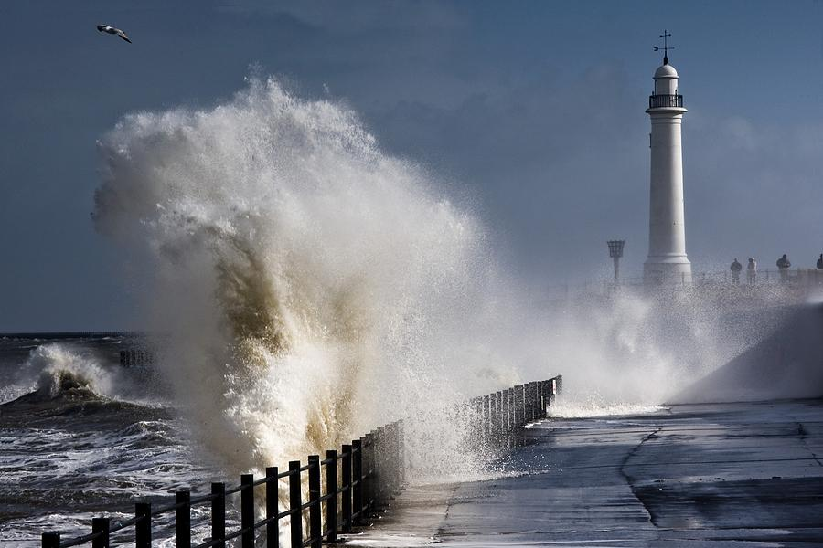 Waves Crashing By Lighthouse At Photograph