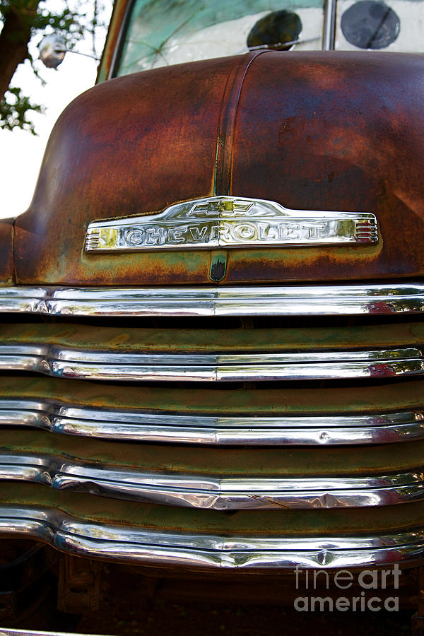 Rusted Antique Chevrolet Car Brand Ornament Photograph  - Rusted Antique Chevrolet Car Brand Ornament Fine Art Print