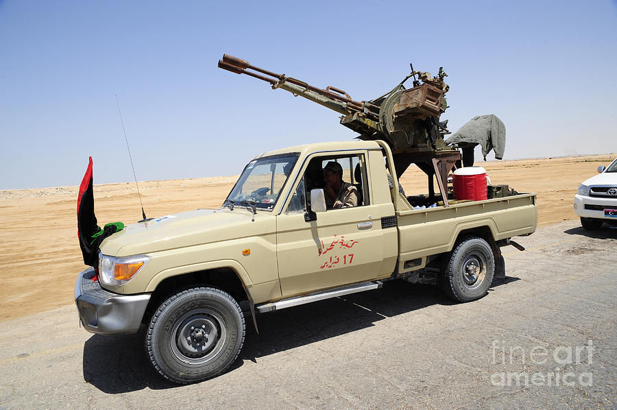 Libya Photograph - A Free Libyan Army Pickup Truck by Andrew Chittock