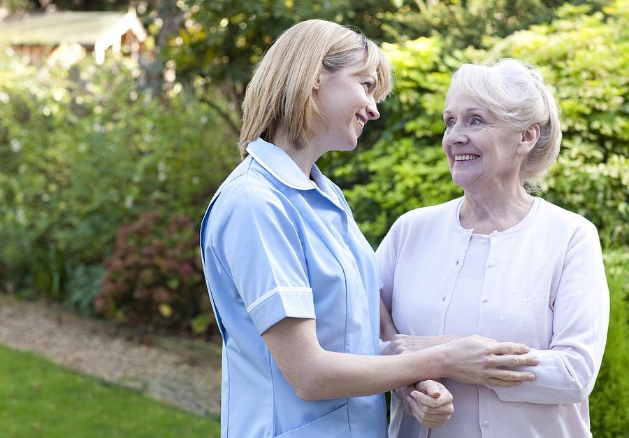 Nurse On A Home Visit Photograph