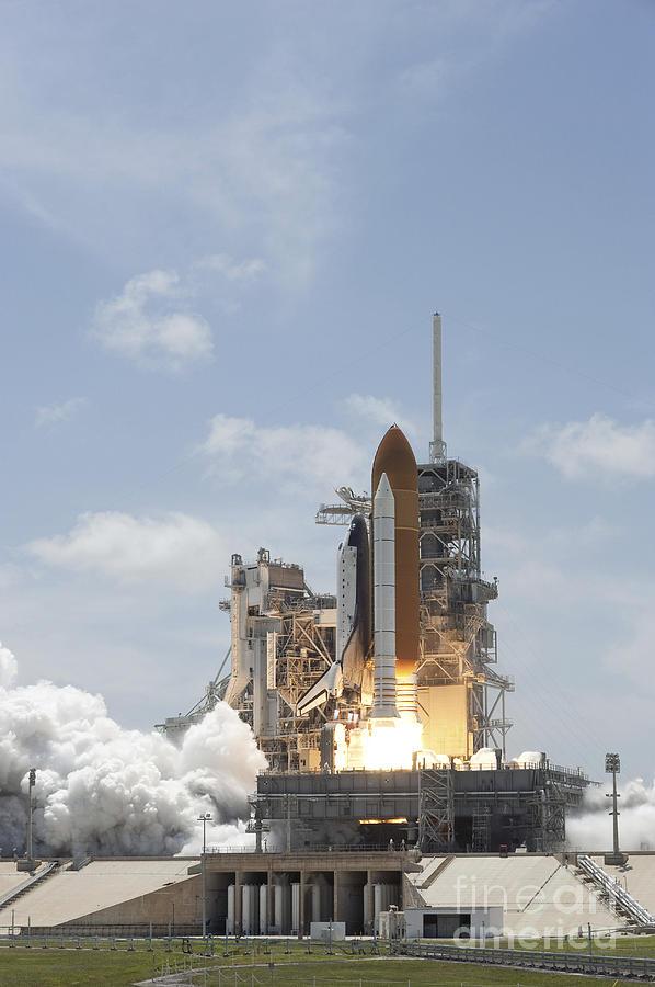 Space Shuttle Atlantis Lifts Photograph