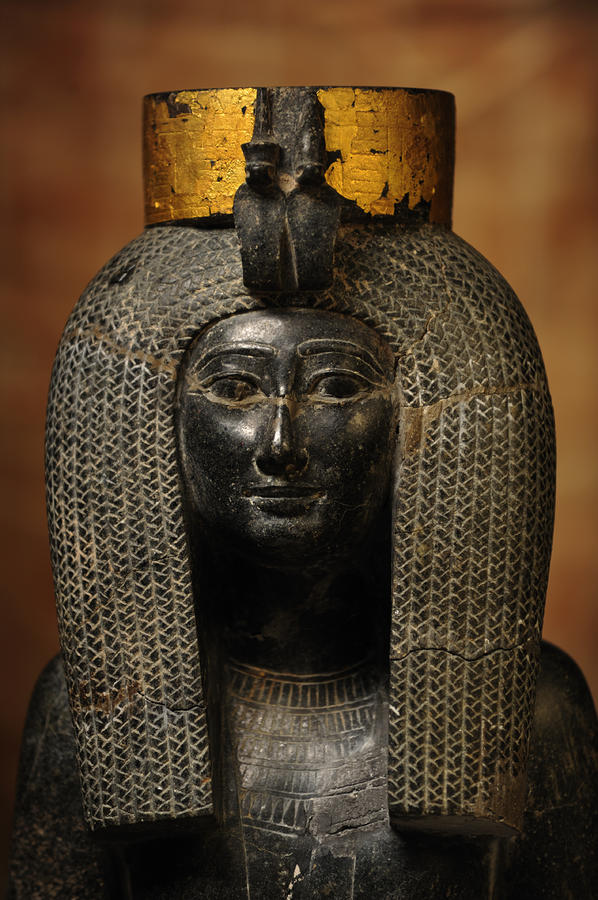 A Black Grantie Statue Of Isis Photograph