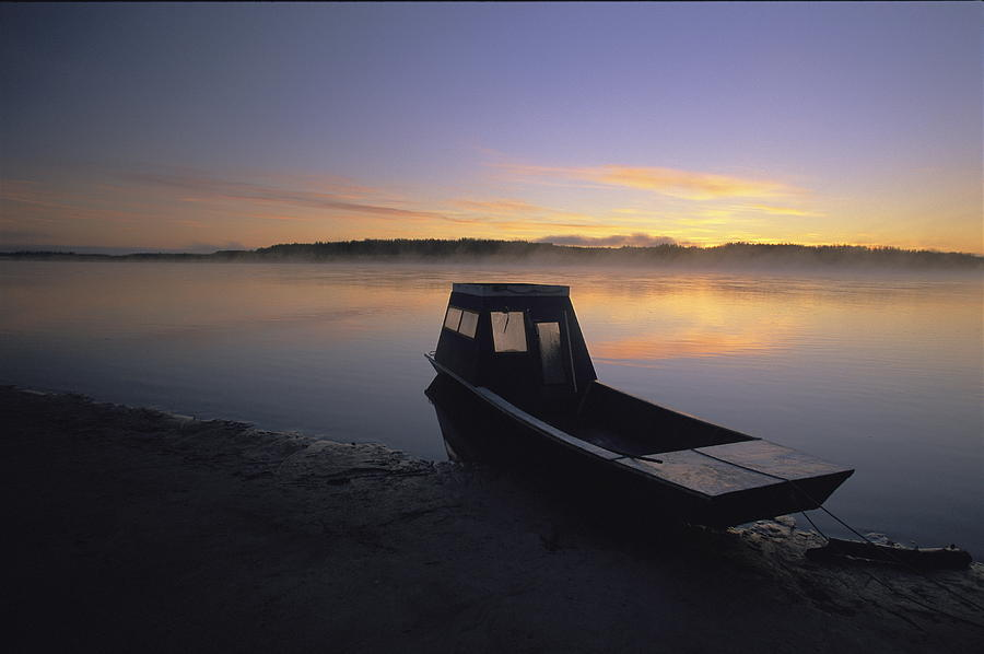 A Boat Sits On The Calm Yukon River Photograph