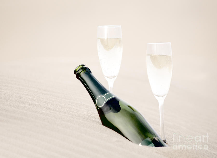 A Bottle Of Champagne With Two Glasses Photograph