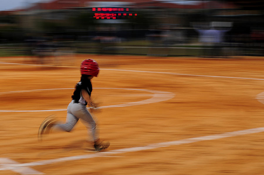 A Boy Runs During A Baseball Game Photograph