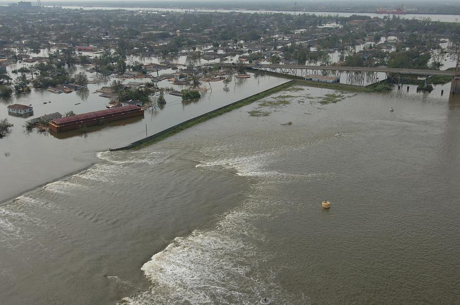 A Breech In A New Orleans Levee Floods Photograph