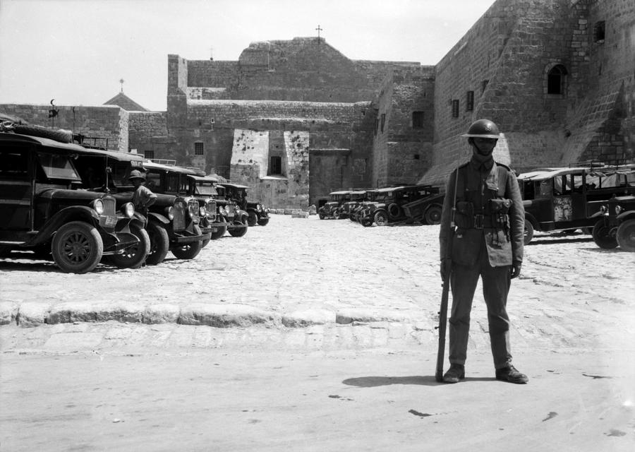 A British Soldier In Front Of Nativity Church Photograph  - A British Soldier In Front Of Nativity Church Fine Art Print