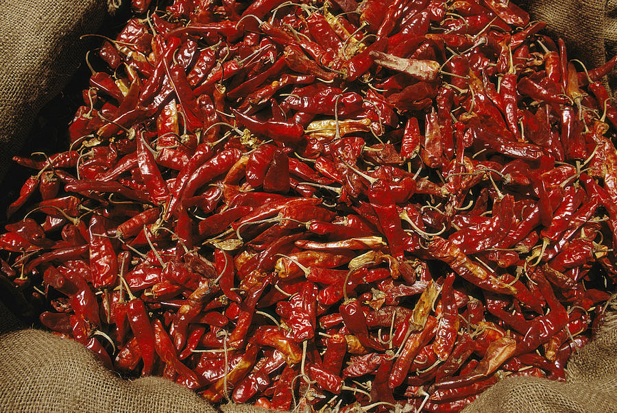 A Burlap Bag Full Of Red Hot Peppers Photograph