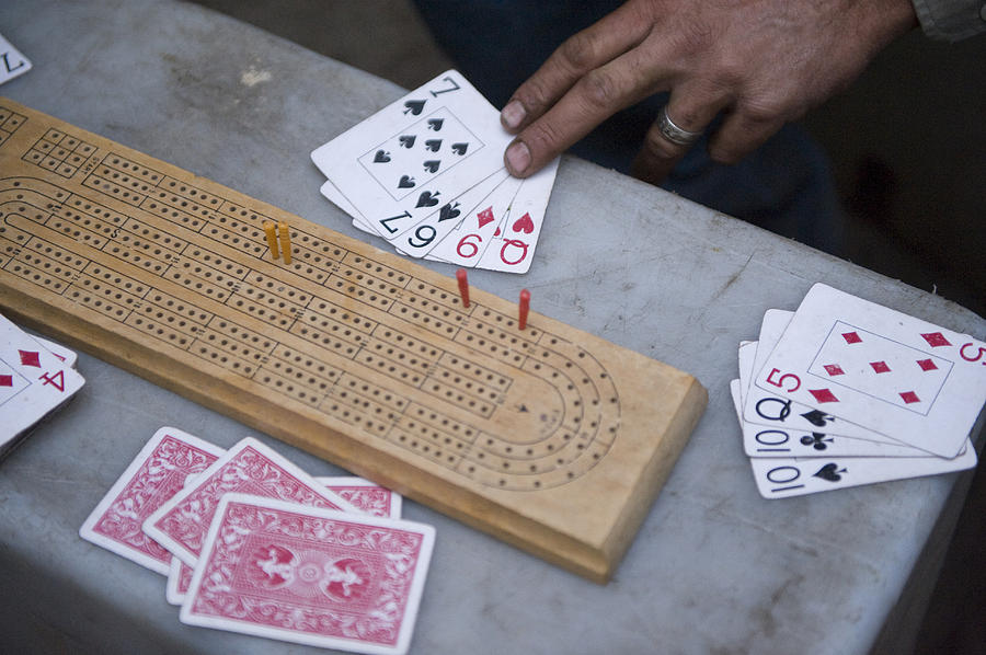 A Card Game Being Played In Kings Photograph