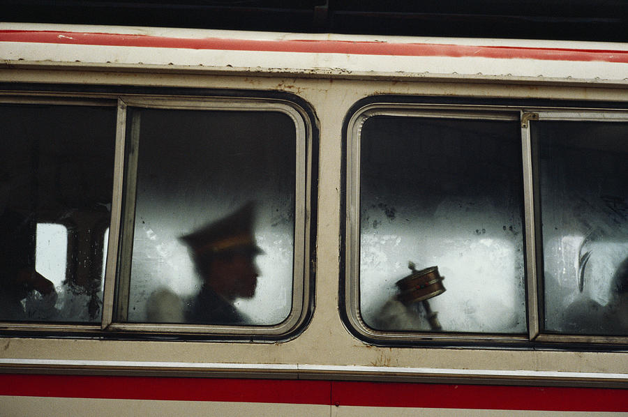 A Chinese Pla Soldier Sits On A Bus Photograph