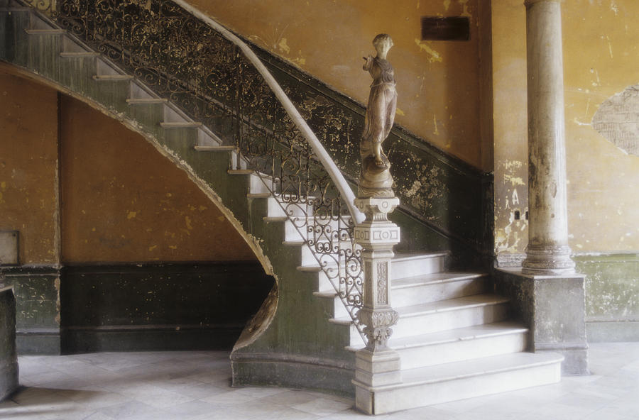 A Circular Marble Staircase And Statue Photograph