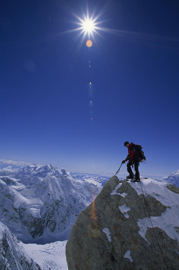 A Climber With An Ice Axe Above Snow Photograph  - A Climber With An Ice Axe Above Snow Fine Art Print