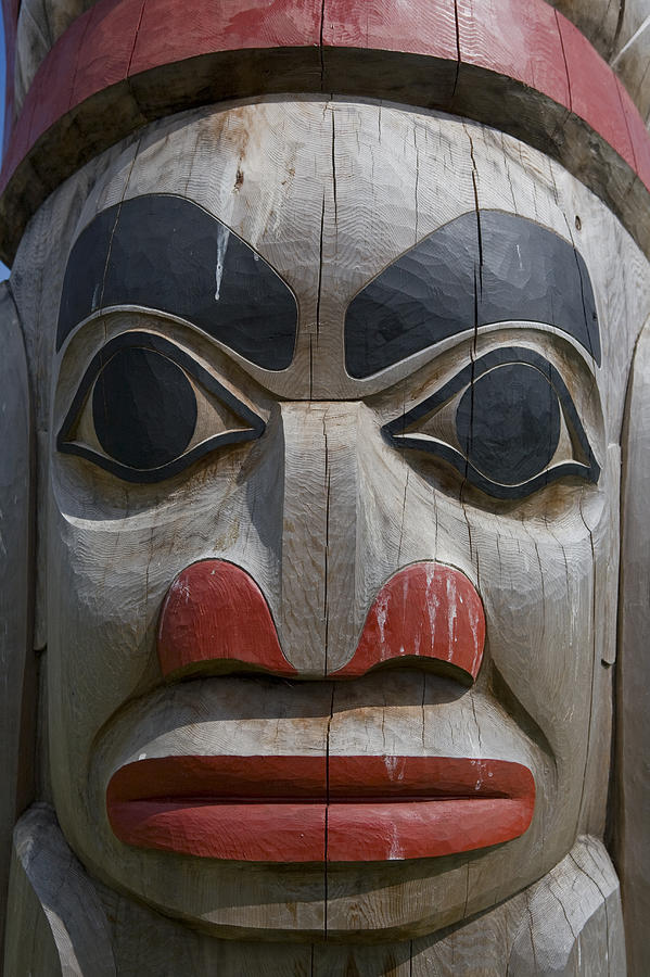 A Close View Of The Carvings Of A Totem Photograph