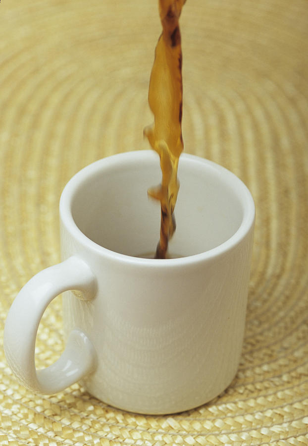 A Cup Of Energy Filled Coffee Is Poured Photograph