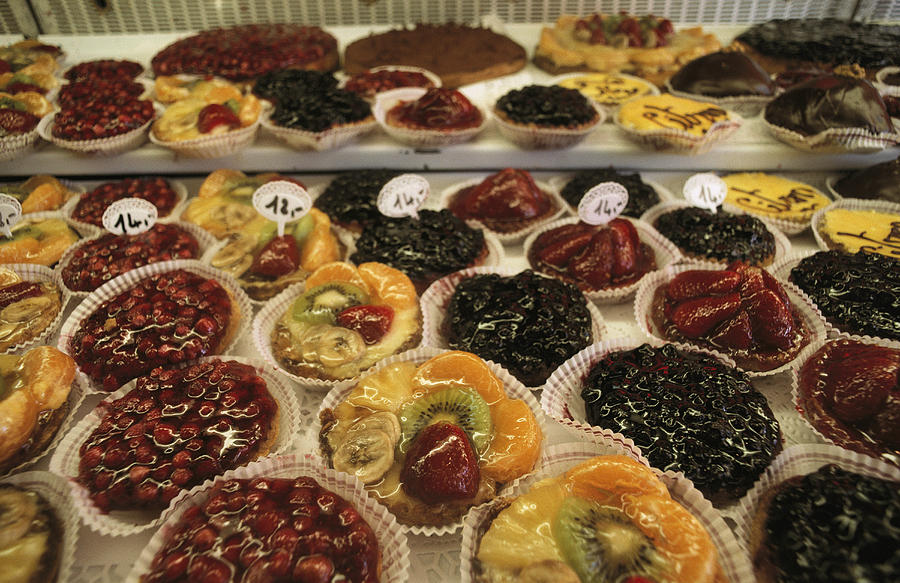 Europe Photograph - A Display Case Full Of Fruit Pastries by Gordon Wiltsie